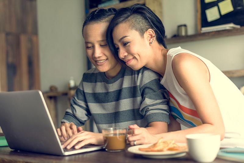 Lesbian couple on laptop